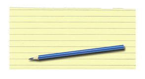 Yellow lined paper and pencil Stock Photography