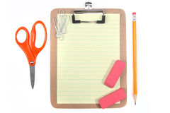 Yellow Lined Paper and School Office Supplies Royalty Free Stock Photography