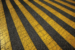 Yellow lines on asphalt Royalty Free Stock Photos