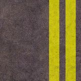 Yellow lines on the asphalt road Stock Photo