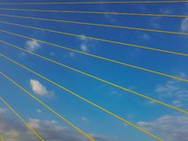 Yellow lines and blue sky. Abstract background royalty free stock image