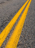 Yellow lines on the highway Stock Photos