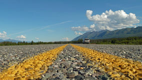 Yellow lines on Highway ground view. Two yellow lines on empty highway in canada Royalty Free Stock Photos