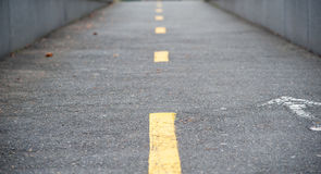 Yellow lines on a narrow street Royalty Free Stock Photo