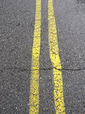 Yellow lines on the road Stock Photography