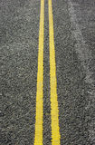 Yellow lines on road Stock Image