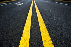 Yellow lines on a straight road. Stock Photography