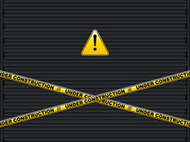Yellow lines with under construction text on roller shutter garage door Royalty Free Stock Photography