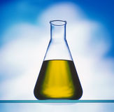 Yellow liquid in flask Stock Photography