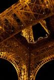 Yellow lit steel structure from under Eiffel tower. Night scene with yellow lit steel structure from under Eiffel tower in Paris royalty free stock photos