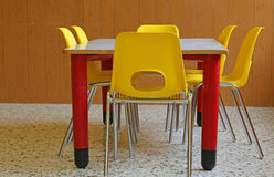 Yellow little chairs in the kindergarten classroom Stock Image