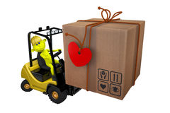 Yellow little man loads a parcel on a loader Royalty Free Stock Image