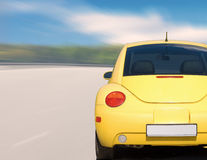 Yellow little racer Royalty Free Stock Photography