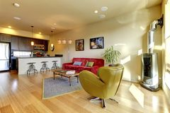 Yellow living room ith red sofa and kitchen. Stock Images