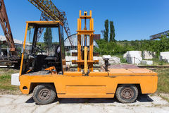 The yellow loader in the background of the gantry crane and warehouse. Royalty Free Stock Image