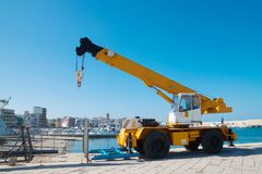 Yellow loading crane in port stock photo