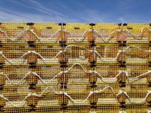Yellow lobster traps against the sky Royalty Free Stock Images