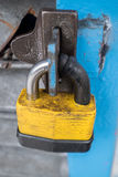 Yellow lock. A rusty yellow big lock Stock Photos