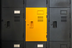 Yellow Locker amongst Black Ones. Yellow Locker amongst Black Lockers Royalty Free Stock Images