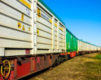 Cargo boxes on the train tracks. White and green Cargo boxes on the train tracks Stock Image