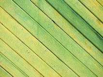 Wooden board fence background. Green yellow Stock Images