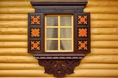 Yellow Log Cabin Wall With One Ornamental Window Royalty Free Stock Image