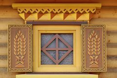 Yellow Log Cabin Wall With One Ornamental Window Royalty Free Stock Photo