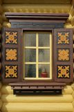 Yellow Log Cabin Wall With One Ornamental Window Stock Photo