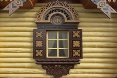 Yellow Log Cabin Wall With One Ornamental Window Stock Photography