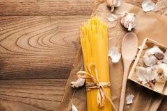 Yellow long spaghetti on a rustic background. Yellow italian pasta. Long spaghetti. royalty free stock image