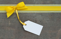 Yellow loop. And label on wooden ground Royalty Free Stock Photography