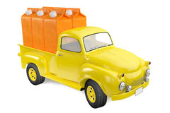 Yellow lorry with packing of orange juice Royalty Free Stock Images