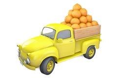Yellow lorry with ripe orange Stock Photo
