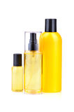 Yellow lotions. Yellow bodycare lotions in bottles on white background Royalty Free Stock Photography