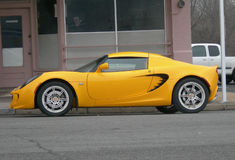Yellow Lotus Automobile. Sporty yellow Lotus Automobile, side view of a European sports car Stock Image