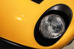Yellow luxury vintage sport car headlight Royalty Free Stock Images