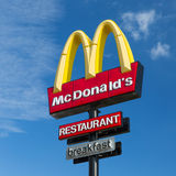 Yellow M sign near McDonalds Restaurant Stock Image