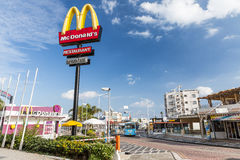 Yellow M sign near McDonalds Restaurant Stock Photo
