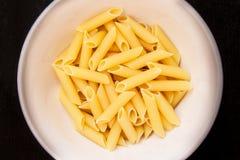 Yellow macaroni, vermicelli food background Stock Photo