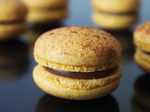 Yellow macarons, chocolate filling Royalty Free Stock Images