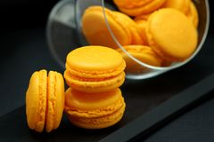 Yellow Macarons Close up in a glass vase royalty free stock images