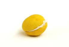 A yellow macaroon Stock Images