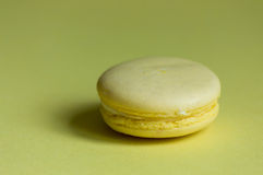 Yellow Macaroon on yellow Stock Images