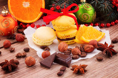 Yellow macaroons with christmas  decorations Royalty Free Stock Photography