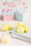 Yellow macaroons with gift boxes on background Stock Images