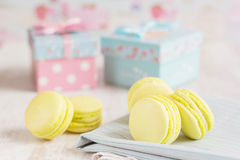 Yellow macaroons with gift boxes on background Stock Image