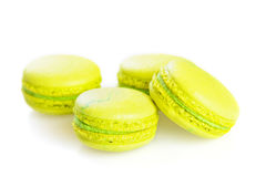 Yellow macaroons isolated on white, selective focus Stock Photos