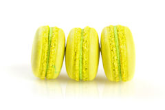 Yellow macaroons isolated on white, selective focus Royalty Free Stock Photo