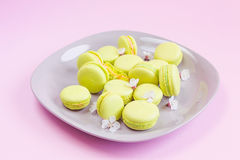Yellow macaroons on plate, selective focus Royalty Free Stock Images