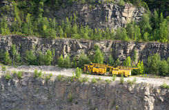 Yellow machines for the extraction of granite Stock Photography